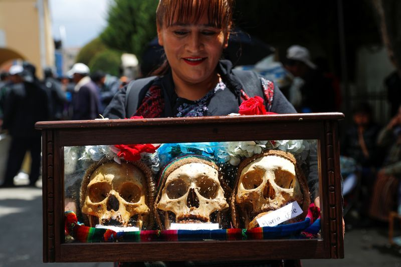Known as ñatitas the skulls are decorated bolivia